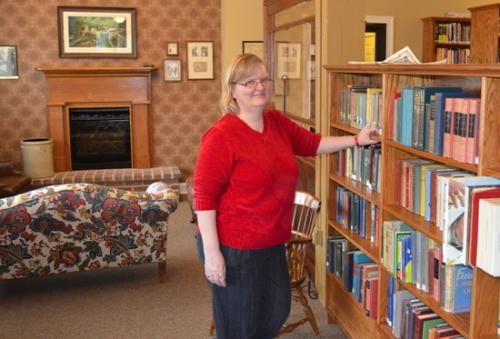 Shown in the E.J. Richards Reading Room, Celia Bandelier, library director at Roanoke Public Library, says the recent move to a larger space has opened up the possibilities for all the programs and activities the library can now offer its patrons.