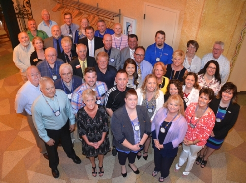 Current members of the Huntington Rotary Club are (front, from left) Annette Carroll, Beka Lemons, Holly Saunders and Nicole Johnson; (second row, from left) Rich Beaver, Adam Drummond, Joe Santa, Dawn Harvey and Megan Reckelhoff; (third row, from left starting in the middle of the photo) Natalie McConnell, Kathy Branham, Mandy Reber and Cindy Krumanaker; (fourth row, from left) Mike Perkins, Jim Hoffman, Steve Pfister, Matt Roth, Chris Sands and Rose Meldrum; (fifth row, from left) Mel Ring, Lyle Juillerat, Randy Sizemore, Mark Wickersham, Kevin Killen, Lori Mickley and David Dyer; (sixth row, from left) Sarah Hain, Rose Wall, Stefan Poling and Billy Winter; (seventh row, from left) Joe Hake, Brooks Fetters, Pat Brown and Chris Fleck; and (eighth row, from left) Dave Mettler John Jepsen and Michael Howell.