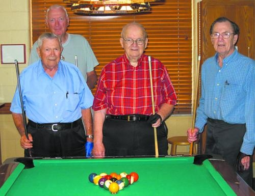 "Norm Hiser (back) gathers with (front row from left) Clarence Myers, Melvin Dooley and Carl Hubbart after Dooley ""ran the table"" during a pool game at Heritage Pointe in Warren."