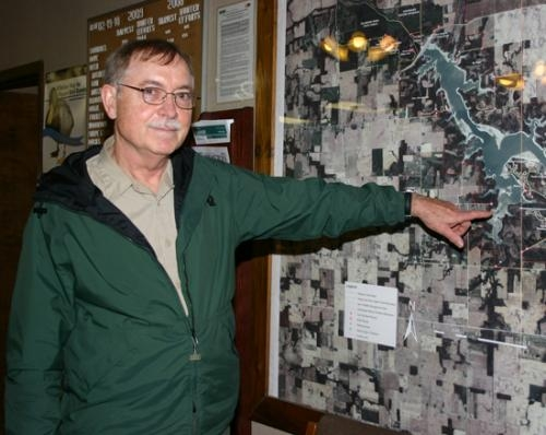 Dennis White, property manager of Salamonie Lake, points to Lost Bridge West on the map in the lake's main office. White, who has been at the lake for 38 years, says updates made to the campground at the end of last year will be new to visitors this year.