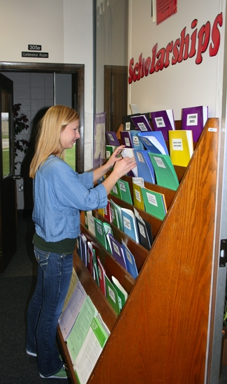 Ana Wenning, senior at Huntington North High School, scopes out the scholarship forms in the guidance department.