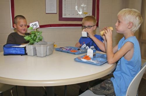 Lincoln Elementary School third-graders (from left) Frank Roth, Kaelan Lease and Landon Emerick enjoy lunch on Thursday, Aug. 30.