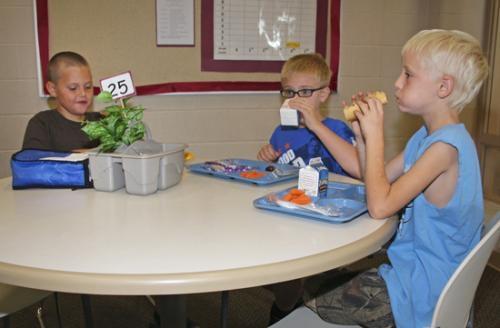 Lincoln Elementary School third-graders (from left) Frank Roth, Kaelan Lease and Landon Emerick enjoy lunch on Thursday, Aug. 30.