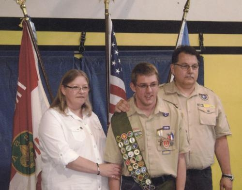 Anthony Schmaltz (center) is recognized after receiving his Eagle award, with his parents, Michelle and Gerald Schmaltz, at his side.