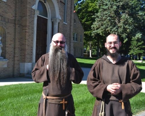 Brother Angelus Maria (left) and Brother Isaac Mary are two of the three professed brothers of the Franciscan Friars Minor leading a class of postulants at the St. Felix Catholic Center, in Huntington. The friars now make their home in half of the former St. Felix Friary, the first group of brothers to occupy the building since 1980.