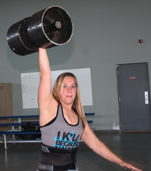 Christina Bangma, of Huntington, works out with a circus dumbbell at Champs Strength Academy on Thursday, Aug. 27. Bangma and teammate Jes Reeve will participate in the North American Strongman Nationals competition on Oct. 2 and 3 in Davenport, IA.