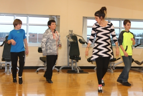 YMCA dance instructor Brooke Farrington (second from right) shows her pupils how it's done as they practice their steps in the boys' tap dance class on Wednesday, Jan. 27. Students are (from left) Austin Taylor, Zander Mason and Tyler Gradeless.