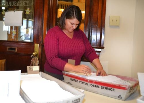 Lori Mower, an employee of the Huntington County treasurer's office, prepares property tax bills for mailing.
