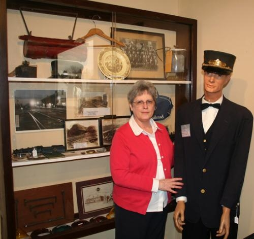 Huntington County Historical Museum Director Pat Bergdall poses with part of the Erie Railroad display currently housed at the museum. The historical society plans to build a replica of the east railroad yards and parts of Huntington that surrounded it.