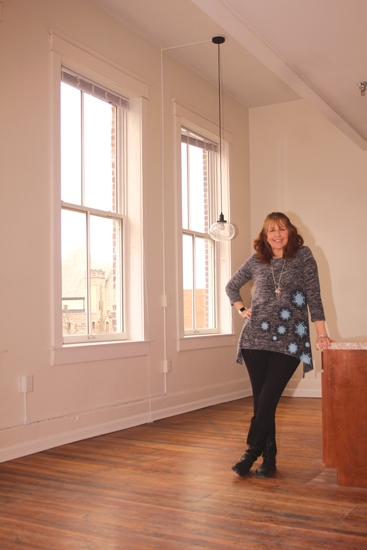 Karen Eilts, the property manager for UB Lofts, in Huntington, stands inside one of the apartments in the UB Block. The apartments are now finished and available to rent, bringing the rehabilitation of the UB Block one step closer to completion.