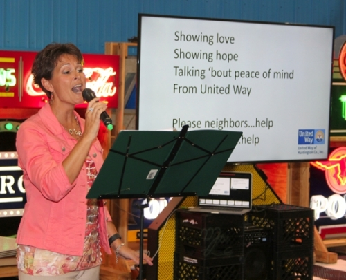 "Nicole Johnson sings a song to the tune of ""Seasons of Love"" Wednesday, Sept. 21, to encourage those in attendance at the United Way kickoff luncheon to give generously during the 2016 fund-raising campaign. About 125 people attended the event, held at Huntington Sheet Metal. Photo by Rebecca Sandlin."