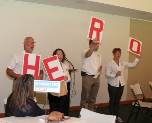 Team Stanley, serving as the campaign chairs of the 2018 Huntington County United Way Campaign, hold up cards spelling what they hope the 14 United Way Pacesetter companies will become as they begin their fund-raising efforts, ahead of the official start of the campaign in September. Pictured are (from left) Brent Stanley, Megan Reckelhoff, Nick Stanley and Darlene Stanley. The skit was performed at the annual Pacesetter Luncheon on Wednesday, July 18, at the Historic Forks of the Wabash.