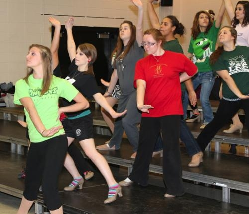 Members of the Varsity Singers at Huntington North High School (from left) Taylor Bailey, Rebecca Shenefield and Alaina Ellenburg practice at the school on Tuesday, Nov. 6, for the Pomp & Plenty gala, to be held at the school on Nov. 17 and 18.