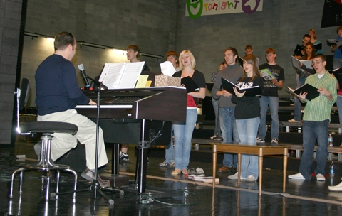 "John Wenning (seated) directs the Huntington North High School Varsity Singers as they rehearse their show on Thursday, Nov. 12, in preparation for the ""Pomp & Plenty"" dinner and concert to be held on Nov. 21-22."