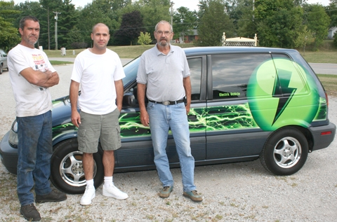 The Sheleys – (from left) Shannon, Josh Sheley and their dad Rowdy Sheley — converted a 1993 Eagle Summit to an electric car. The project, which started last Fourth of July, was completed early this spring.