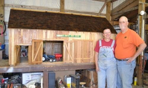 Eva and Greg Witkamp show off the barn Greg crafted in his rural Warren workshop as a surprise for a young family member.