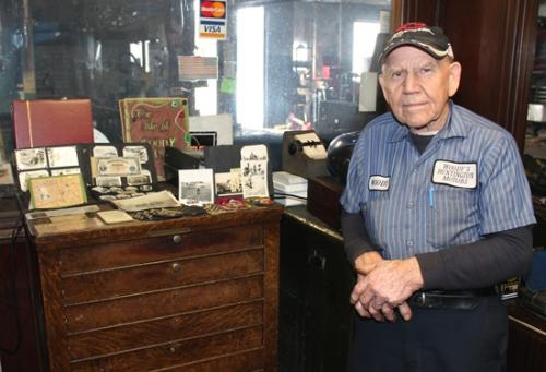 Woody Schnitz, of Huntington, stands with mementos from his time in the army during World War II. Schnitz served from 1945 to 1947 and recently went on a trip to Washington, D.C. through Honor Flight Northeast Indiana to see the WWII memorial.