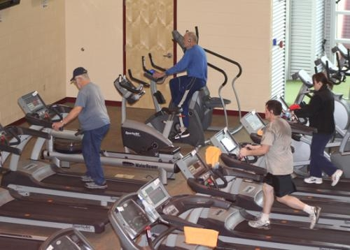 Parkview Huntington Family YMCA members are busy on Thursday afternoon, March 21, working out on the facility's machines.