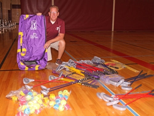 Tim Allen, the sports director at the Parkview Huntington Family YMCA, pauses for a moment from sorting through equipment for the YMCA's new youth golf program, which he will be organizing. The program, called DRIVE, was created by The First Tee, a sports organization that seeks to interest youth in golf