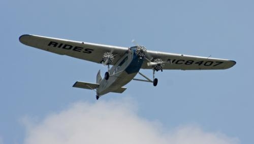 "A 1929 Ford Tri-Motor glides across the skies above Huntington Municipal Airport on Thursday, June 26. The aircraft visited Huntington June 26 to 29, offering flights that recreate air travel in the ""Golden Age of Aviation."""