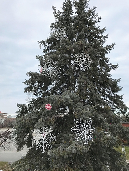 """A tree, """"Ol' Henry"""", at St. Peter's First Community Church (SPFCC) in Huntington, has been adorned with lights and dozens of handmade snowflakes and hand painted candies, officially transforming Ol' Henry into """"Ol' Henry the Christmas Tree."""""""