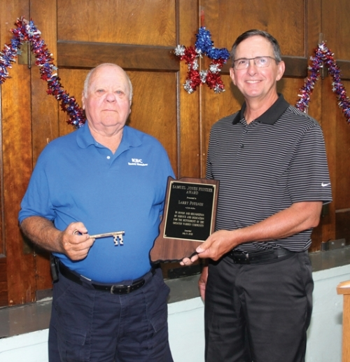 Larry Poulson (left) holds the 2019 Warren's Samuel Jones Pioneer Award, presented to him by the 2018 recipient, Jeff Souder, during a breakfast held Friday, July 5, at the Knight Bergman Center. Poulson also holds the Key to the Town of Warren, which was also presented to him. Both awards acknowledged Poulson's many years of service to the community as an electrician, fire chief, EMS driver, volunteer and board member.