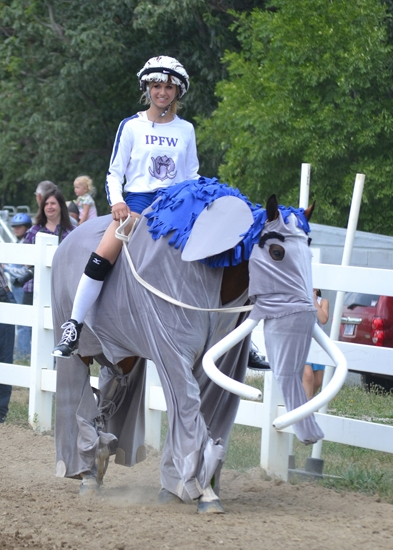 """Jessie Earhart's horse was transformed into a mastodon, the mascot of Indiana-Purdue University Fort Wayne, for the costume contest at the 4-H Horse and Pony Show. Earhart wore IPFW gear in keeping with the contest's """"favorite school"""" theme."""