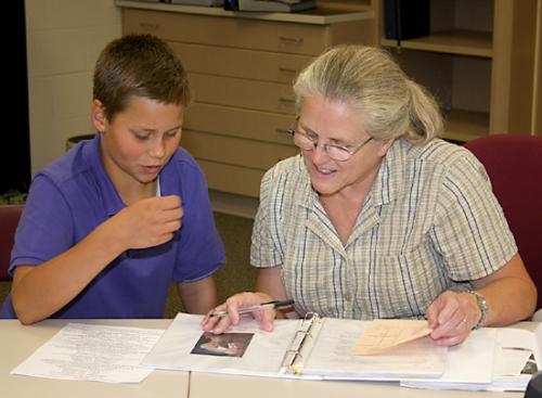 Josef Thomson (left) explains his genealogy project to judge Dee Moore during non-livestock project judging at Lincoln Elementary School on Thursday, July 19, as part of the Huntington County 4-H Fair.