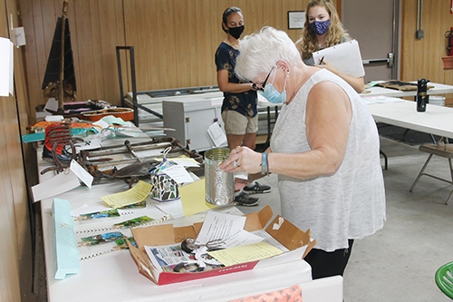 Teresa Wells, of Warsaw, judges the recycled materials projects entered by 4-H'ers in the Huntington County 4-H Fair on Thursday, July 23.