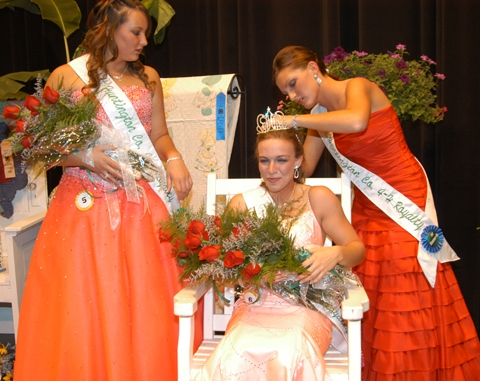 Mindi Hoffman (right), first runner-up in the Huntington County 4-H Fair royalty contest held Friday, July 17, at Huntington North High School, helps royalty champion Alli Harris (center) fix her crown as second runner-up Kiela Clore (left) looks on.