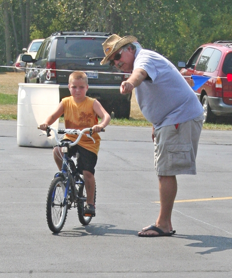 Judge Mike Shatto gives Spencer Roth instruction on how to navigate the bike rodeo course during the 2011 Homespun Day festivities in Zanesville. The bike rodeo will again be part of this year's festival, starting at noon on Saturday, Sept. 1.