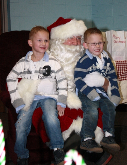 "Lucas (left) and Logan Goodrich pose for a picture with Santa during last year's Christmas in ""Our Town"" festivities in Markle. Santa Claus is scheduled to arrive in Markle on Saturday morning, Dec. 1, to kick off a celebration of the 2012 holiday."