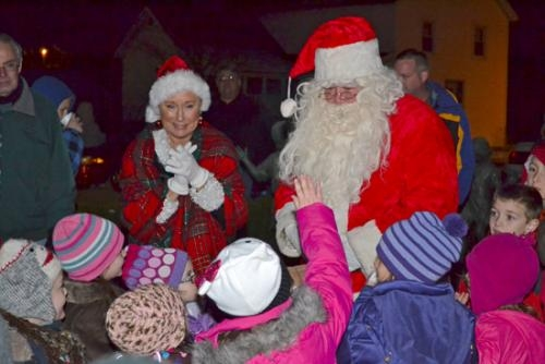Santa and Mrs. Claus greet children after their 2011 arrival in Roanoke. The couple is set to return to Roanoke on Friday, Dec. 7, at 6 p.m.