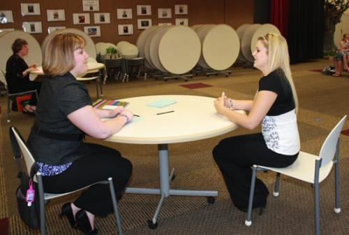 Darian LaVine (right) discusses her outfit with 4-H judge Danielle Smith at the 2012 Consumer Clothing judging held at Lincoln Elementary School, on Tuesday, July 17.