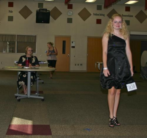 Senior 4-H'er Morgan Nightingale models her formal wear for judge, Valorie Clarkson, during the 4-H Fashion Revue Judging on Tuesday morning, July 17 at Lincoln Elementary School.
