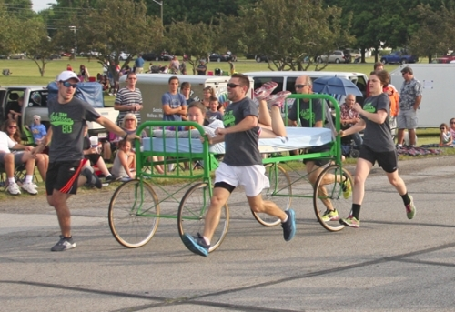 Team Johnson – JJ's Convenience Stores sprints down the course during the Heritage Days Bed Race last year at Huntington North High School. The team won the competition and was also voted crowd favorite. This year's bed race will take place on Saturday, June 17, at 7:30 p.m., again at HNHS.