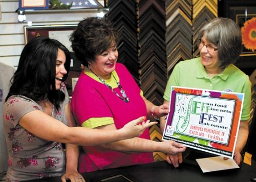 Dana Spahr, Debbie Dyer and Paula Bittner (from left) display the poster Spahr designed for this summer's JeFFFest. Dyer is executive director of the LaFontaine Arts Council, which sponsors the event.
