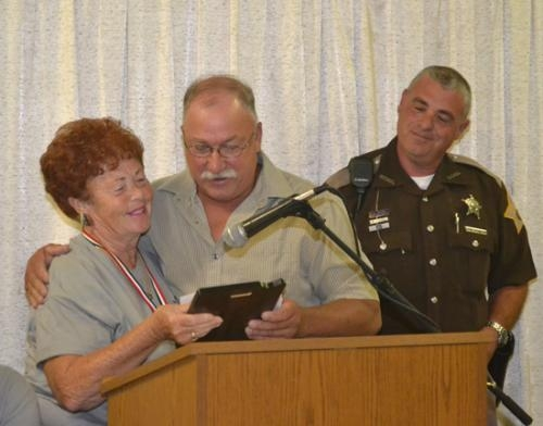 Tim Ford (center), recipient of the 2013 Samuel Jones Pioneer Award, receives his award from Bonnie Boxell, the 2012 recipient, on Friday, July 5, in Warren. At right is Boxell's son, Ron Boxell, who assisted in announcing the honor.