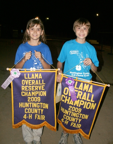 After all the events at the Huntington County 4-H Llama Show on Monday, July 20, at Chief LaFontaine Saddle Club, Jennifer Meyer (left) and David Prather were named reserve champion and overall champion, respectively.