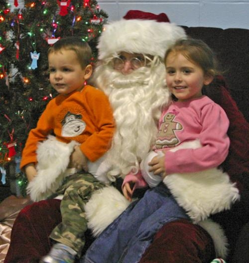 """Siblings Brice (left) and Harleigh Peterson share Santa's lap during last December's Christmas in """"Our Town"""" celebration in Markle. Santa and a host of seasonal activities return to Markle for this year's celebration on Saturday, Dec. 7."""
