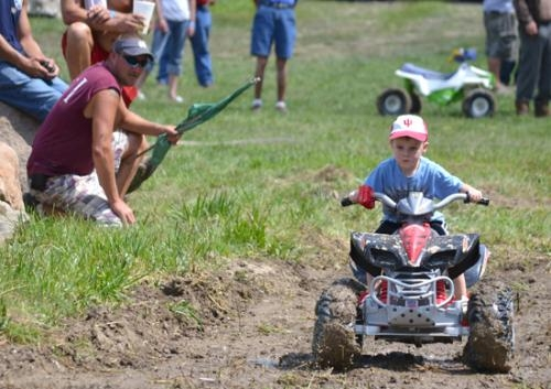 Caedyn Hartwig powers his mini four-wheeler through the mud during the kids' division of the Andrews Western Days mud bogs last year. The mud bogs this year will be held Saturday, Aug. 25, starting at 11:30.