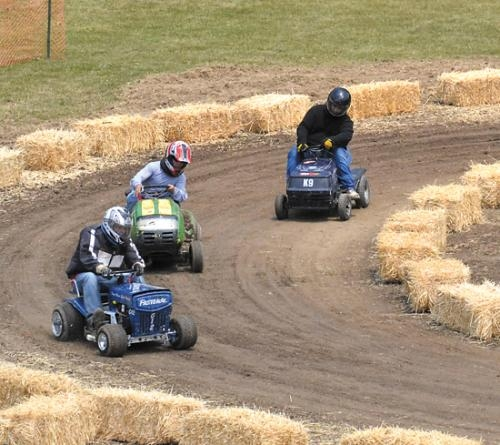 Racers on riding mowers make a turn during the 2012 Salamonie Summer Festival in Warren.