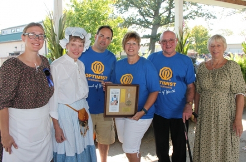 Members of the Huntington Optimist Club accept the 2017 Arrowhead Award Saturday, Sept. 23, from the Forks of the Wabash Pioneer Festival Committee during a ceremony held at the festival. Celebrating the occasion are (from left) Rachelle Nightenhelser, festival co-chair; Optimist Club members Midge Decker, Jamie Groves, Paula Whiting and Jim Wilson; and Bonita Price, festival co-chair.
