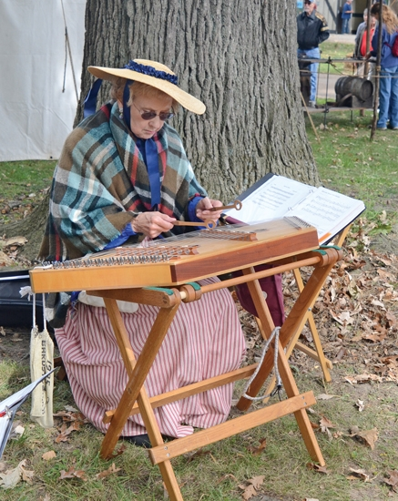 Beverly Williams, of Fort Wayne, entertains with a selection on the hammered dulcimer, a pioneer days instrument, at the 43rd annual Forks of the Wabash Pioneer Festival last year at the Huntington County Fairgrounds.