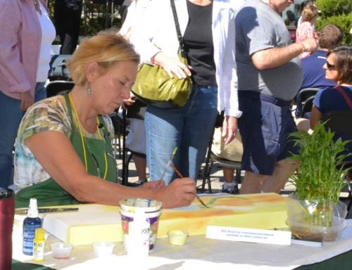 Vicki Junk-Wright works on a painting at her booth during the 2011 Renaissance in Roanoke festival. This year's event will be held on Saturday, Oct. 13, from 10 a.m. to 5 p.m. in downtown Roanoke.
