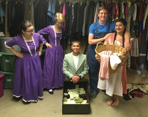 "Jackson Lunsford (center) delivers a newly-discovered treasure that will save the Pureheart family from being tossed out in the cold by a wicked landlord. Rejoicing in the find are (from left) Alexis Keplar, Claire Driscoll, Angus Jones and Kiana Kistler. The scene is from ""Polly Pureheart Prevails,"" to be presented throughout the weekend during the Forks of the Wabash Pioneer Festival this Saturday and Sunday."