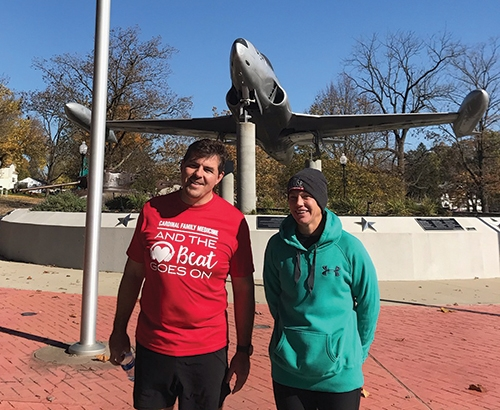 After running an Ultra 50K – over 31 miles – Huntington Mayor Richard Strick (left) and his friend and co-runner Brandi Krumanaker stand in front of the T-33 Shooting Star jet at the Veterans Memorial in Memorial Park, where a Purple Heart monument has been incorporated. Strick and Krumanaker ran the Ultra 50K as part of the Marine Corps Marathan Trifecta, which also included a 10K and a marathon. The duo completed the trifecta as a way to raise funds and awareness for the Purple Heart Gateway Arch project in Huntington.