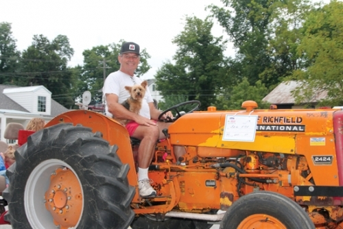 Ageless Iron Tractor Club member Sam Elliot lets his dog hitch a ride on his 1964 International tractor as he makes his way down Main Street in Roanoke during last year's Roanoke Fall Festival tractor parade. This year's festival will run from Thursday, Sept. 7, to Saturday, Sept. 9.