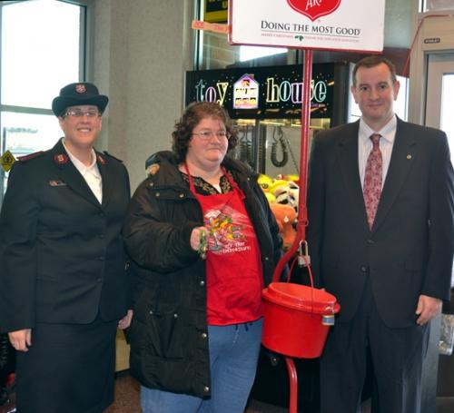 Salvation Army Capt. Barbara McCauley (left) and Stefan Poling (right), chairman of The Salvation Army board of directors, flank bell ringer Teresa Bragg (center) at Owen's North on Saturday, Nov. 17, the first day the red kettles were placed.