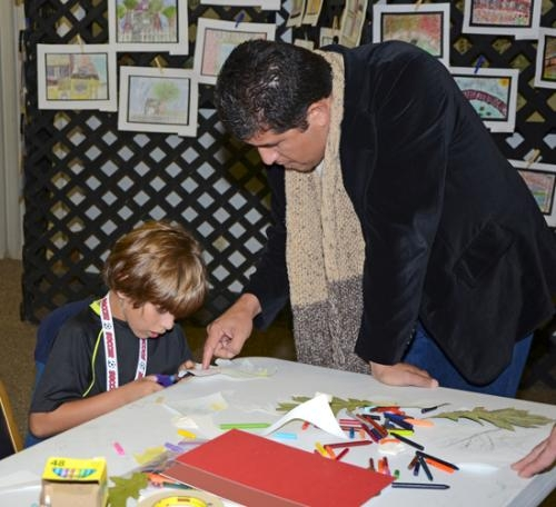 Abi Dominguez (left) and his dad, Nacho Dominguez, create a piece of art to take home from last year's Renaissance in Roanoke art festival. The event returns this year on Saturday, Oct. 12.
